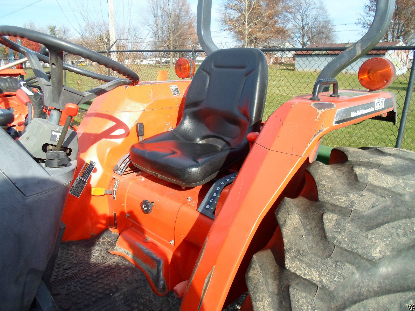 High Back Black seat for Kubota B-Series and L-Series Compact tractors with  6″ x 2″ and 7 5″ x 2″ Bolt Mounting Patterns #IR